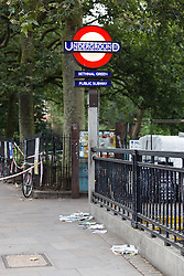 © Licensed to London News Pictures. 30/07/2016. LONDON, UK. Bethnal Green tube station sign within the Police cordon outside Bethnal Green tube station on Cambridge Heath Road, where a man in his 30's was stabbed and later died in hospital last night.  Photo credit: Vickie Flores/LNP