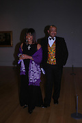 Mr. and Mrs. Paul Boateng. Turner Whistler Monet, exhibtion opening dinner, Tate Britain. 7 February 2005, ONE TIME USE ONLY - DO NOT ARCHIVE  © Copyright Photograph by Dafydd Jones 66 Stockwell Park Rd. London SW9 0DA Tel 020 7733 0108 www.dafjones.com
