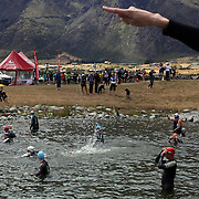 Competitors enter the water for competition during the Active Q T Ultimate Tri Series Jack's Point Triathlon, Jack's Point,  Queenstown, Otago, New Zealand. 14th January 2012. Photo Tim Clayton