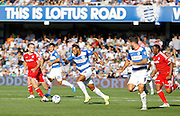 Matt Phillips attacks the Cardiff defence with a dangerous looking run during the Sky Bet Championship match between Queens Park Rangers and Cardiff City at the Loftus Road Stadium, London, England on 15 August 2015. Photo by Andy Walter.
