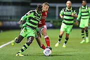 Forest Green Rovers Toni Gomes(25) runs past Swindon Town's Paul Mullin(7) during the EFL Sky Bet League 2 match between Forest Green Rovers and Swindon Town at the New Lawn, Forest Green, United Kingdom on 22 September 2017. Photo by Shane Healey.