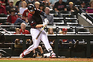 PHOENIX, AZ - APRIL 30:  Brandon Drury #27 of the Arizona Diamondbacks hits a two run home run against the Colorado Rockies during the sixth inning at Chase Field on April 30, 2016 in Phoenix, Arizona.  (Photo by Jennifer Stewart/Getty Images)