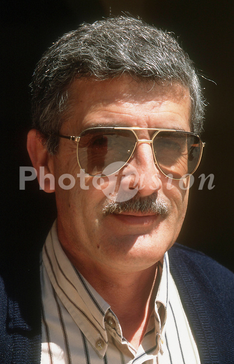 Portrait of man with moustache wearing sunglasses,