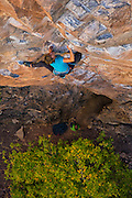 "Writer, editor, and climber Alison Osius climbing ""Feline"" 5.11 at Rifle Mountain Park in Colorado."