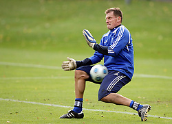 HSV goalkeeper Frank Rost gets hit were it hurts during training.