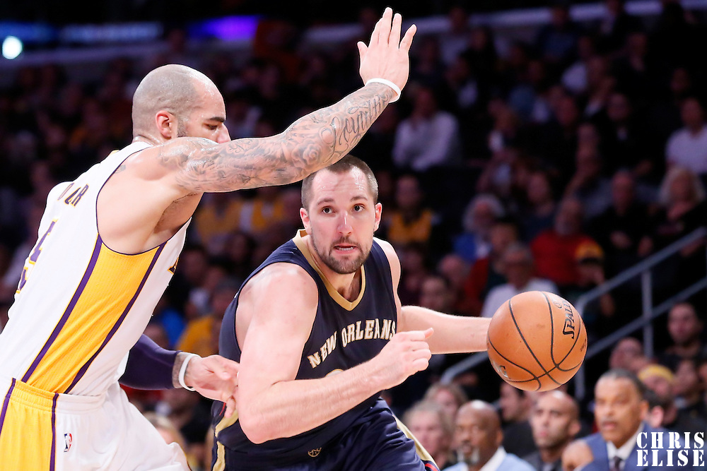 07 December 2014: New Orleans Pelicans forward Ryan Anderson (33) drives past Los Angeles Lakers forward Carlos Boozer (5) during the New Orleans Pelicans 104-87 victory over the Los Angeles Lakers, at the Staples Center, Los Angeles, California, USA.