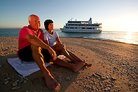 An elderly couple enjoy the sunset during a Coral Princess cruise from Townsville to Cairns in far north Queensland.
