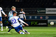 Wycombe Wanderers defender Jack Grimmer (19) takes a shot at goal during the The FA Cup match between Wycombe Wanderers and Tranmere Rovers at Adams Park, High Wycombe, England on 20 November 2019.