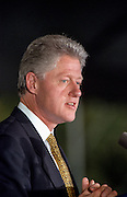 US President Bill Clinton gives an acceptance speech after being awarded the Paul O'Dwyer Peace and Justice Award during a ceremony on the South Lawn of the White House September 11, 1998 in Washington, DC. Clinton received the  for Clinton's work in helping bring peace in Northern Ireland. The ceremony took place the same day the Starr Report was released to Congress.