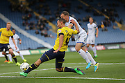 Oxford United midfielder Kemar Roofe (4) whips in a cross during the Sky Bet League 2 match between Oxford United and AFC Wimbledon at the Kassam Stadium, Oxford, England on 10 October 2015.
