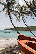Beached boat points out to Spring Bay in Bequia West Indies