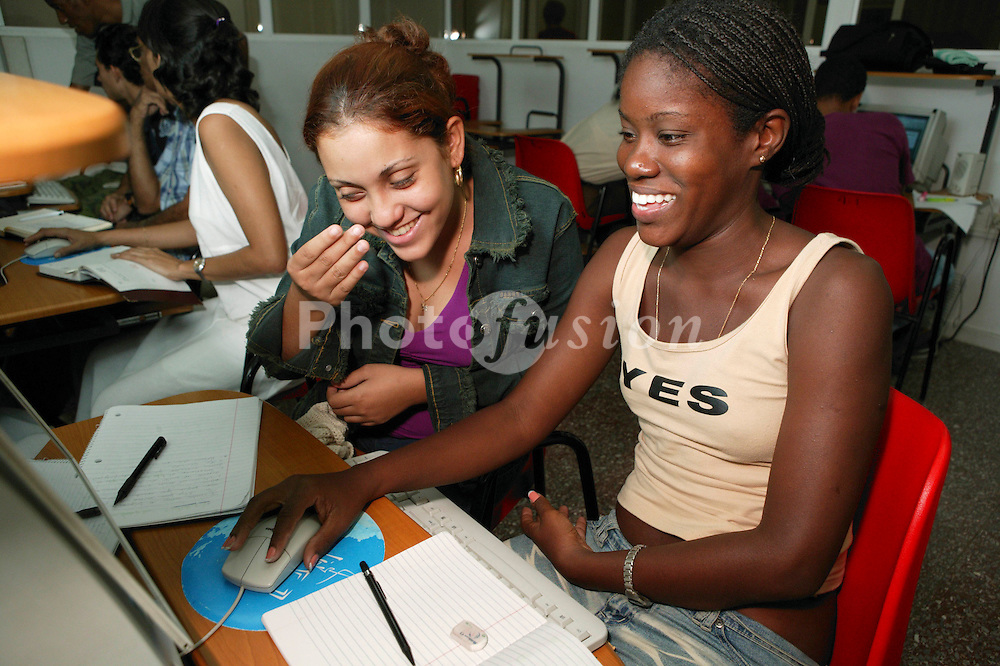 Young women doing computer training at Joven Club; Havana; Cuba,