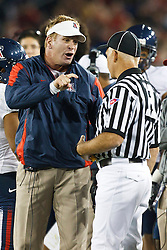 November 6, 2010; Stanford, CA, USA;  Arizona Wildcats head coach Mike Stoops argues with head linesman Jeff Hansen (right) during the second quarter against the Stanford Cardinal at Stanford Stadium.