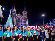 """23 DECEMBER 2018 - CHANTABURI, THAILAND: Carolers sing at the Cathedral of the Immaculate Conception's Christmas Fair in Chantaburi. Cathedral of the Immaculate Conception is holding its annual Christmas festival, this year called """"Sweet Christmas @ Chantaburi 2018"""". The Cathedral is the largest Catholic church in Thailand and was founded more than 300 years ago by Vietnamese Catholics who settled in Thailand, then Siam.   PHOTO BY JACK KURTZ"""
