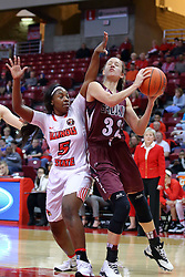 29 January 2017: Brechelle Beachum leans into shooter Kylie Giebelhausen during an College Missouri Valley Conference Women's Basketball game between Illinois State University Redbirds the Salukis of Southern Illinois at Redbird Arena in Normal Illinois.