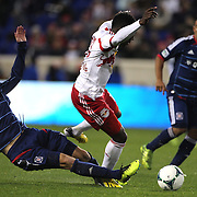 Lloyd Sam, (right), New York Red Bulls, is fouled by Gonzalo Segares, Chicago Fire, during the New York Red Bulls V Chicago Fire, Major League Soccer regular season match at Red Bull Arena, Harrison, New Jersey. USA. 27th October 2013. Photo Tim Clayton