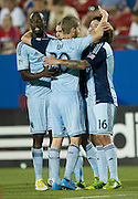 FRISCO, TX - JUNE 22:  Sporting Kansas City celebrates after an own goal by Je-Vaughn Watson #27 of FC Dallas on June 22, 2013 at FC Dallas Stadium in Frisco, Texas.  (Photo by Cooper Neill/Getty Images) *** Local Caption ***
