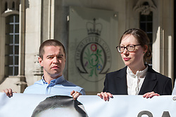 "© Licensed to London News Pictures. 08/05/2018. London, UK. Sam Hallam (left) arriving at the Supreme Court, pictured next to Jodie Blackstock, Legal Director of JUSTICE. Hallam is appealing for ""miscarriage of justice"" compensation. He spent over seven years in jail after he was wrongly sentenced to life in 2005 for a gang-related murder in north London that he did not commit. Photo credit : Tom Nicholson/LNP"