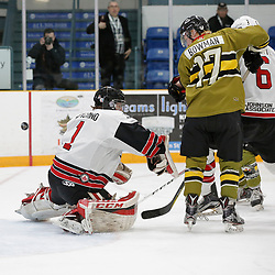 "TRENTON, ON  - MAY 4,  2017: Canadian Junior Hockey League, Central Canadian Jr. ""A"" Championship. The Dudley Hewitt Cup. Game 5 between The Georgetown Raiders and The Powassan Voodoos. Josh Astorino #1 of the Georgetown Raiders and  Parker Bowman #17 of the Powassan Voodoos during the first period <br /> (Photo by Amy Deroche / OJHL Images)"