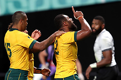 Australia's Samu Kerevi (right) celebrates scoring his fifth try during the 2019 Rugby World Cup Pool D match at Sapporo Dome.