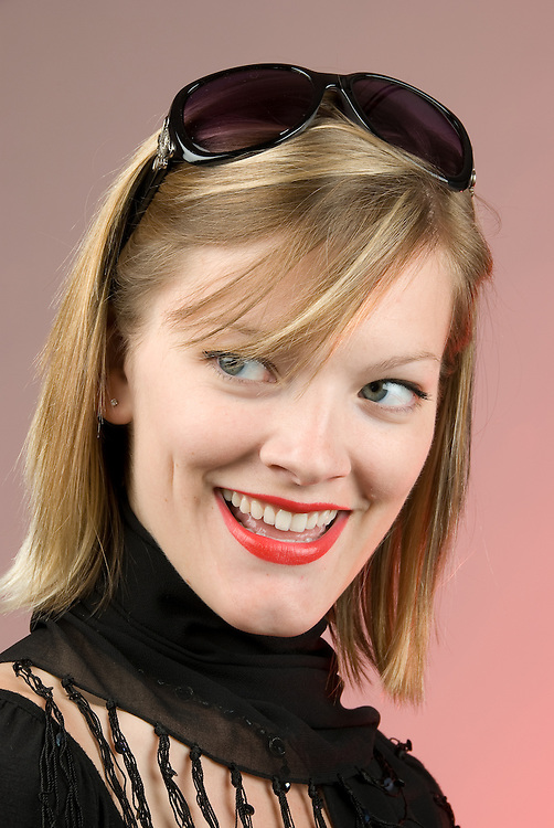 studio shot of model with sunglasses on head