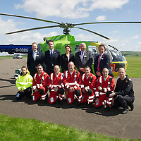 Scotland's Charity Air Ambulance (SCAA) launches from Perth Airport....22.05.13<br /> Back row from left, Alan Bell, John Bullough, Joyce Leslie, Mike Beale and Gavin Davey.<br /> Front row from left, John Stupart pilot, Paramedics Alex Holden, Andy Walker, Bruce Rumgay, Wayne Auten, John Pritchard and pilot Russell Myles.<br /> Picture by Graeme Hart.<br /> Copyright Perthshire Picture Agency<br /> Tel: 01738 623350  Mobile: 07990 594431