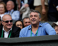 Wimbledon Championships 2011, AELTC,London,.ITF Grand Slam Tennis Tournament . ex Tennis Profi Slobodan ?ivojinovi? (SRB) unterstuetzt seinen Landsmann  Novak Djokovic auf dem Centre Court,Fan, Zuschauer,Tribuene,Halbkoerper,Querformat,