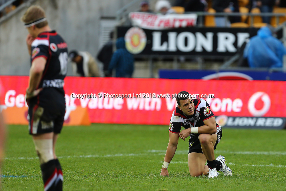 Carlos Tuimavave of the Warriors looks dejected after the loss to the Panthers after the NRL game, Vodafone Warriors v Penrith Panthers, Mt Smart Stadium, Auckland, Sunday 19 August  2012. Photo: Simon Watts /photosport.co.nz