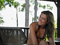 Thailand young woman wearing bikini relaxing in chair portrait