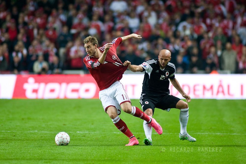 04.09.2015. Copenhagen, Denmark. <br /> Nicklas Bendtner (L) of Denmark fights for the ball with                     Arlind Ajeti (R) of Albania during their UEFA European Champions qualifying round match at the Parken Stadium. Photo: © Ricardo Ramirez.