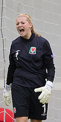 19.08.2013, Parcy Scarlets, Swansea, ENG, UEFA Damen U19 EM, Wales vs Daenemark, Gruppe A, im Bild Wales' goalkeeper Alice Evans looks dejected as Denmark score the opening goal during the UEFA women U 19 championchip group A match between Wales and Denmark at Parcy Scarlets in Swansea, Great Britain on 2013/08/19. EXPA Pictures &copy; 2013, PhotoCredit: EXPA/ Propagandaphoto/ David Rawcliffe<br /> <br /> ***** ATTENTION - OUT OF ENG, GBR, UK *****