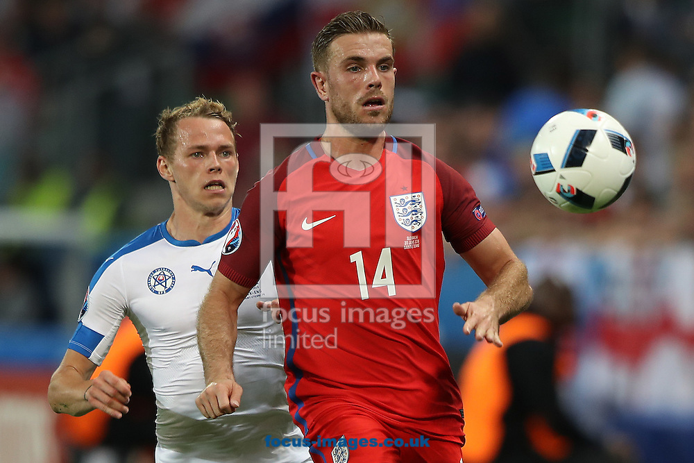Ondrej Duda of Slovakia and Jordan Henderson of England in action during the UEFA Euro 2016 match at Stade Geoffroy-Guichard, Saint-Etienne<br /> Picture by Paul Chesterton/Focus Images Ltd +44 7904 640267<br /> 13/06/2016