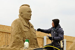 © Licensed to London News Pictures. 26/03/2013. Weston-super-Mare, UK.  Sand sculptor Pedro Mira works on a sculpture of Robert De Niro from Taxi Driver.  He also made sculptures of Audrey Hepburn and Alfred Hitchcock.  The Sand Sculpture Festival at Weston-super-Mare beach.  This year's theme is Hollywood with sculptors from around the world working on film icons carved out of sand.  The festival opens to the public from 29 March.  26 March 2013..Photo credit : Simon Chapman/LNP