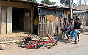 Repairing the bicycle on the street close to Jorhat, Assam, India.