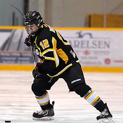 LINDSAY, ON - Feb 7 : Ontario Junior Hockey League Game Action between the Lindsay Muskies and the Aurora Tigers , Noah Delmas #12 of the Aurora Tigers Hockey Club shoots the puck during third period game action.<br /> (Photo by Andy Corneau / OJHL Images)