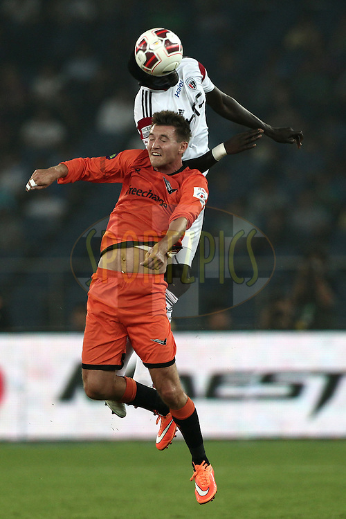 Mads Junker of Delhi Dynamos FC and Massamba Lo Sambou of NorthEast United FC in action during match 16 of the Hero Indian Super League between The Delhi Dynamos FC and NorthEast United FC held at the Jawaharlal Nehru Stadium, Delhi, India on the 29th October 2014.<br /> <br /> Photo by:  Deepak Malik/ ISL/ SPORTZPICS