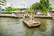 21 NOVEMBER 2012 - BANGKOK, THAILAND:  People cross Khlong Saen Saeb on a small ferry that is pulled across the Khlong by a pulley system. There are only a few ferries that cross the Khlong. They use a winch to pull the boat across the Khlong. The fare is 2 Thai Baht, about $0.10 (US). Bangkok used to be criss crossed by canals (called Khlongs in Thai) but most have been filled in and paved over. Khlong Saen Saeb is one of the few remaining khlongs in Bangkok with regular passenger boat service. Khlong Saen Saeb was dug in 1837 to be a military supply line from Bangkok to Siamese armies battling Annamese (now Vietnamese) forces in what is now Cambodia. Boats and ships play an important in daily life in Bangkok. Thousands of people commute to work daily on the Chao Phraya Express Boats and fast boats that ply Khlong Saen Saeb. Boats are used to haul commodities through the city to deep water ports for export.   PHOTO BY JACK KURTZ