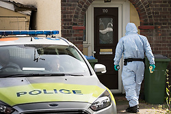 © Licensed to London News Pictures. 24/06/2018. London, UK. A police forensics officer enters a property in Greenwich after the body of a woman in her 50s was found in the garden yesterday. Photo credit: Peter Macdiarmid/LNP