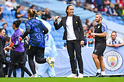 Casey Stoney of Manchester United Women (Manager) during the warm up during the FA Women's Super League match between Manchester City Women and Manchester United Women at the Sport City Academy Stadium, Manchester, United Kingdom on 7 September 2019.