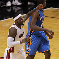 Jun 19, 2012; Miami, FL, USA; Miami Heat small forward LeBron James (6) signals to the bench after an injury during the fourth quarter in game four in the 2012 NBA Finals against the Oklahoma City Thunder at the American Airlines Arena. Mandatory Credit: Derick E. Hingle-US PRESSWIRE