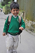Young child in uniform on the way to school Darjeeling, West Bengal, India