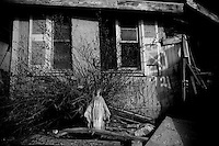 A statue of mother mary sits infront of a home destroyed in the lower ninth ward over a month after hurricane katrina made lanfall 8 October 2005 New Orleans Louisiana.  (photo by Darren Hauck)