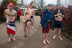 © Licensed to London News Pictures.30/11/2013. London, UK. Members of the Serpentine Swimming Club prepare to swim in the cold water of the Serpentine Lake in Hyde Park, London, during the swimming club's winter competition.Photo credit : Peter Kollanyi/LNP