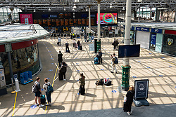 Edinburgh, Scotland, UK. 17 June, 2020. Views from Edinburgh city centre before expected relaxation of covid-19 lockdown by Scottish Government. Pictured; Passengers observing social distancing on concourse of Waverley Station Iain Masterton/Alamy Live News