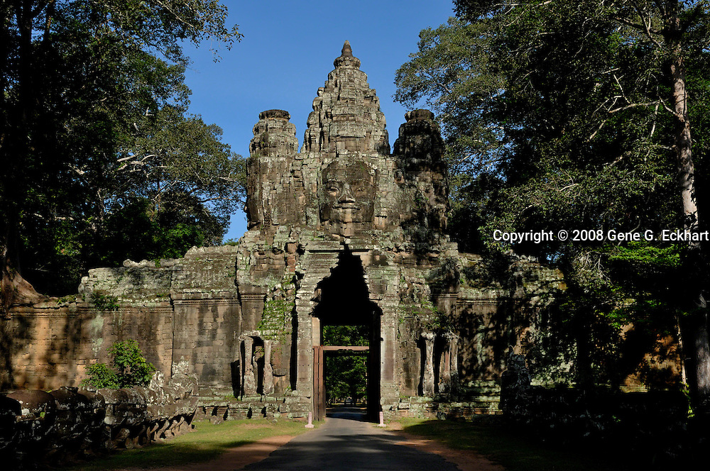 This gateway lies between Angkor Wat and Angkor Thom, two of the most visited sites in the Angkor temple complex.<br /> <br /> Angkor Wat (Khmer: អង្គរវត្ត) was first a Hindu, later a Buddhist, temple complex in Cambodia and the largest religious monument in the world. The temple was built by the Khmer King Suryavarman II in the early 12th century in Yaśodharapura (Khmer: យសោធរបុរៈ, present-day Angkor), the capital of the Khmer Empire, as his state temple and eventual mausoleum. Breaking from the Shaiva tradition of previous kings, Angkor Wat was instead dedicated to Vishnu. As the best-preserved temple at the site, it is the only one to have remained a significant religious center since its foundation. The temple is at the top of the high classical style of Khmer architecture. It has become a symbol of Cambodia, appearing on its national flag, and it is the country's prime attraction for visitors.<br /> <br /> Angkor Wat combines two basic plans of Khmer temple architecture: the temple-mountain and the later galleried temple, based on early Dravidian architecture, with key features such as the Jagati. It is designed to represent Mount Meru, home of the devas in Hindu mythology: within a moat and an outer wall 3.6 kilometres (2.2 mi) long are three rectangular galleries, each raised above the next. At the centre of the temple stands a quincunx of towers. Unlike most Angkorian temples, Angkor Wat is oriented to the west; scholars are divided as to the significance of this. The temple is admired for the grandeur and harmony of the architecture, its extensive bas-reliefs, and for the numerous devatas adorning its walls.<br /> <br /> The modern name, Angkor Wat, means &quot;Temple City&quot; or &quot;City of Temples&quot; in Khmer; Angkor, meaning &quot;city&quot; or &quot;capital city&quot;, is a vernacular form of the word nokor (នគរ), which comes from the Sanskrit word nagara (नगर). Wat is the Khmer word for &quot;temple grounds&quot; (Sanskrit: वाट vāṭa &quot;&quot;enclosure&quot;).