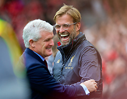LIVERPOOL, ENGLAND - Saturday, September 22, 2018: Liverpool's manager Jürgen Klopp and Southampton's manager Mark Hughes share a joke before the FA Premier League match between Liverpool FC and Southampton FC at Anfield. (Pic by Jon Super/Propaganda)