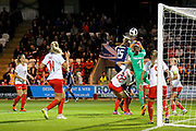 Gaelle Thalmann (#1) of Switzerland punches the ball clear as Sophie Howard (#15) of Scotland tries to connect with a header during the 2019 FIFA Women's World Cup UEFA Qualifier match between Scotland Women and Switzerland at the Simple Digital Arena, St Mirren, Scotland on 30 August 2018.