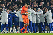 Chelsea players and staff celebrate as Tottenham Hotspur goalkeeper Paulo Gazzaniga (22) walks off the pitch dejected, during the EFL Cup semi final second leg match between Chelsea and Tottenham Hotspur at Stamford Bridge, London, England on 24 January 2019.