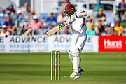 Ben Sanderson of Northamptonshire hits the ball to the boundary for four runs during the Specsavers County Champ Div 2 match between Sussex County Cricket Club and Northamptonshire County Cricket Club at the 1st Central County Ground, Hove, United Kingdom on 30 June 2019.