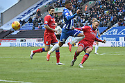 Wigan Athletic Defender, Reece Wabara gas to go over a clearence during the Sky Bet League 1 match between Wigan Athletic and Oldham Athletic at the DW Stadium, Wigan, England on 13 February 2016. Photo by Mark Pollitt.